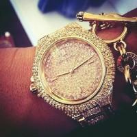 altın sarısı taşlı Michael kors kol saati kadın