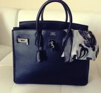 siyah deri kol çantası hermes